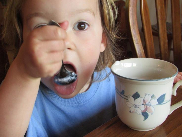 Anabel eating yogurt